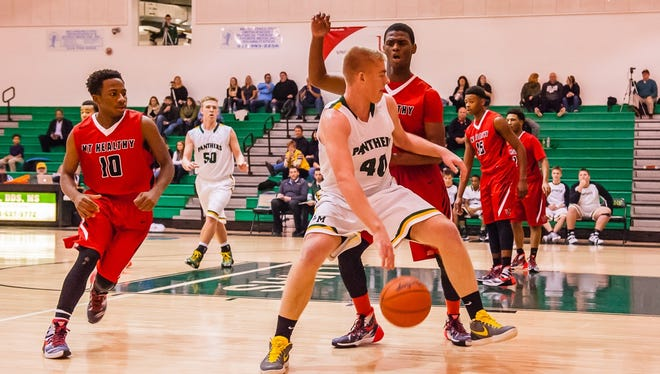 Little Miami's Alexander Johnson, junior, drives toward the basket against Mt. Healthy.