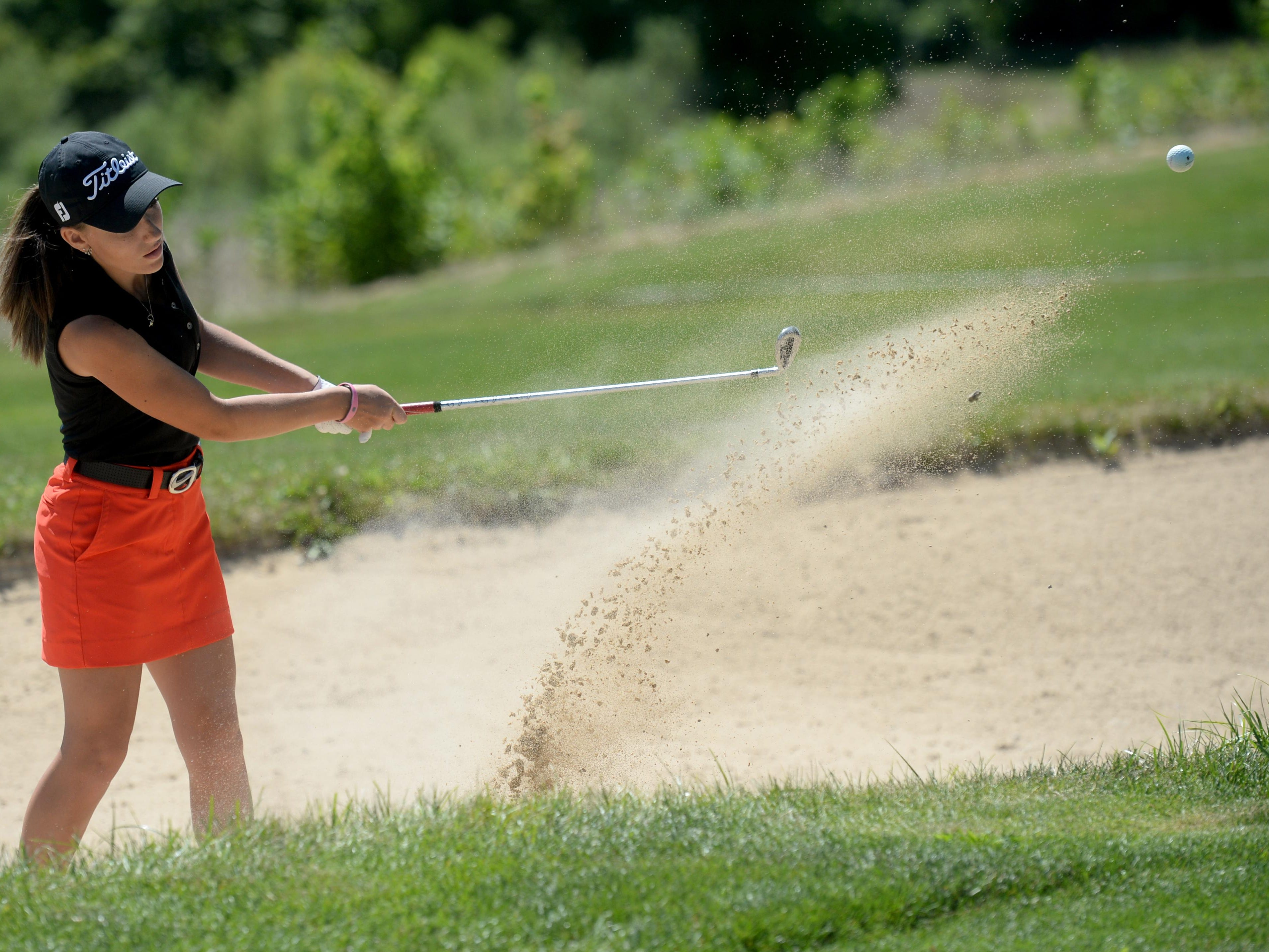 Richmond High School golfer Angela Roggero hits out of a bunker Thursday during practice at Elks Country Club in Richmond.