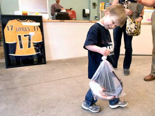 Predators fan Caleb Daniel, 5, of Franklin picked out a catfish at Little's Fish Market on Friday, May 4, 2018. Daniel will help throw to a catfish on the ice before Preds game on Saturday. While Daniel lived at Vanderbilt Children's waiting for a heart transplant, he would throw his stuffed catfish off the bed.