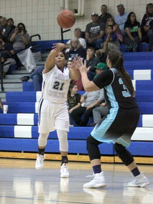 Silver's Aysia Salas led the Lady Colts with 19 points Tuesday night against Santa Teresa. Above, she finds an open teammate and passes the ball down low during first half action.