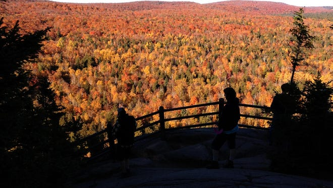 Hikers take in one of eight overlooks along the 1.8-mile Oberg Mountain loop trail, off U.S. Highway 61 north of Tofte.