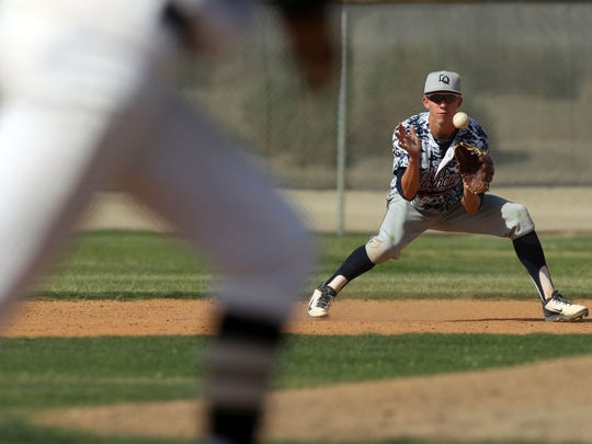 La Quinta's Clay Fisher stops a Xavier College Prep ground ball on Tuesday, April 22, 2014 in Palm Desert.