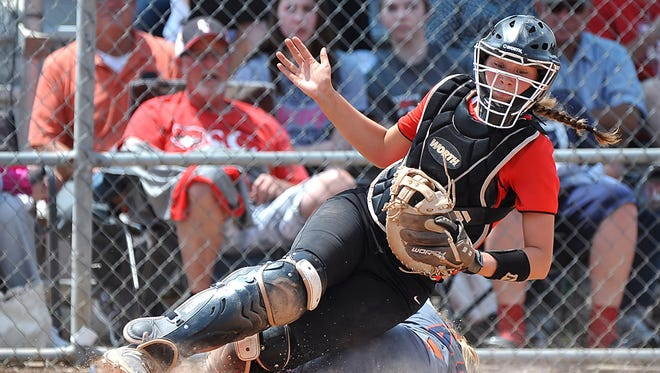 Stewarts Creek catcher Ciera Dobbins goes down after a close play at home during the Lady Red Hawks' first state tournament appearance last month.