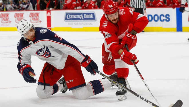 Blue Jackets defenseman Seth Jones and Red Wings right wing Martin Frk battle for the puck in the first period on Nov. 11, 2017, at Little Caesars Arena.