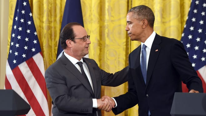 President Obama and French President Francois Hollande shake hands during a joint press conference at the White House on Nov. 24, 2015.
