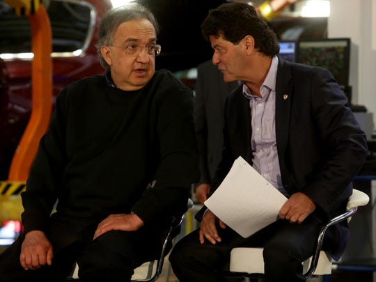 Sergio Marchionne, the chairman and CEO of Fiat Chrysler Automobiles (FCA) talks with Jerry Dias, the president of Unifor before their talk to employees at the FCA Windsor Assembly Plant in Windsor, Ontario Canada on Friday, May 6, 2016.Eric Seals/Detroit Free Press