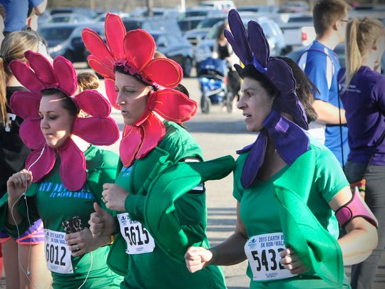 Runners in Friday's Earth Day 5K race dressed up for