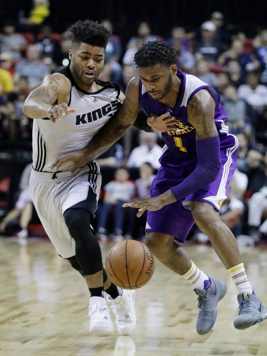 Los Angeles Lakers' Vander Blue drives around Sacramento Kings' Frank Mason III during the second half of an NBA summer league basketball game, Monday, July 10, 2017, in Las Vegas. (AP Photo/John Locher)