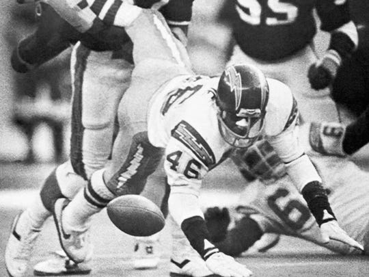 San Diego Chargers running back Chuck Muncie (46) loses the football as he is pounded by Cincinnati Bengals linebacker Roggie Williams.