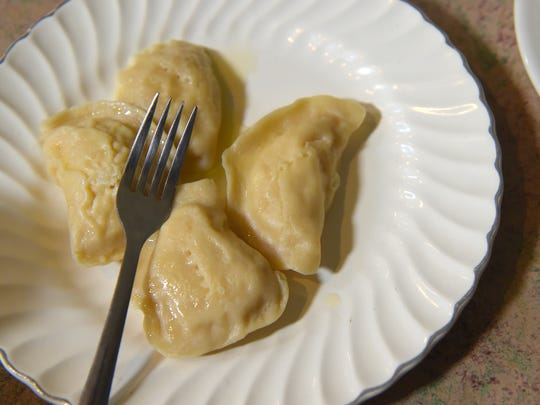 "Homemade pyrohy at Sacred Heart Ukrainian Catholic Church. ""Pyrohy"" is the Ukranian spelling of ""pierogi,"" the popular Polish dumpling commonly filled with potato and served with onions."