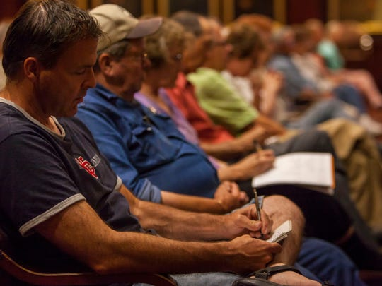 Iron County residents take notes during the commissioner