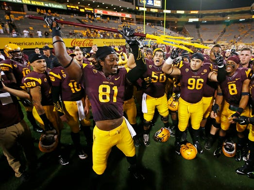 Arizona State wide receiver Gary Chambers holds up the pitchfork after beating Weber State 45-14 in the season opener on Thursday, Aug. 28, 2014, at Sun Devil Stadium in Tempe, Ariz.
