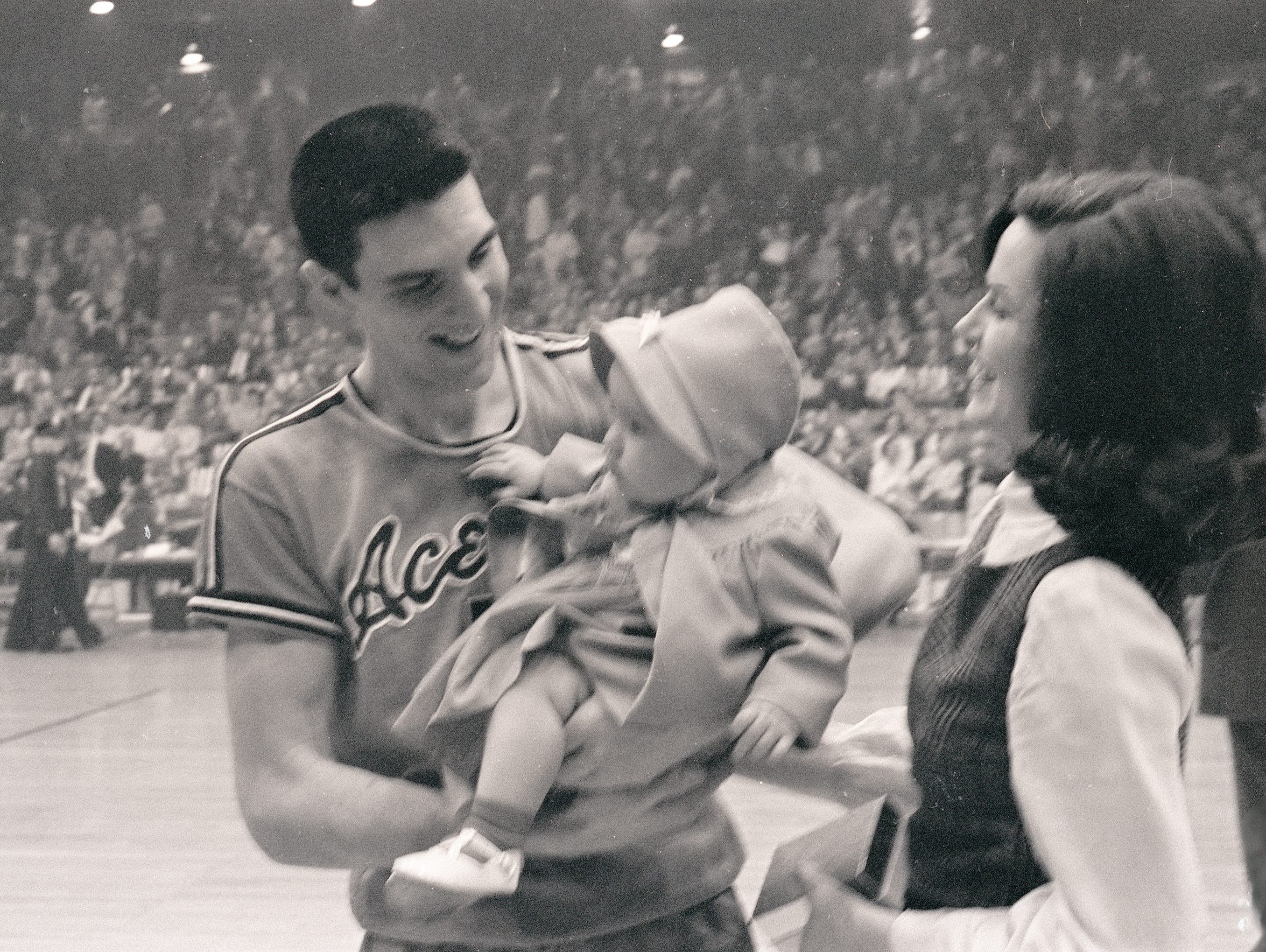 Jerry Sloan greets his wife, Bobbye and his daughter following the 1965 NCAA College Division Championship game at Roberts Stadium. UE won over Southern Illinois 85-82.