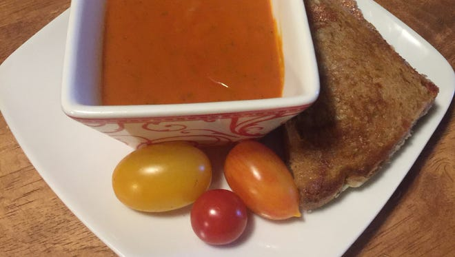 Soup made with garden fresh tomatoes, served with grilled cheese.