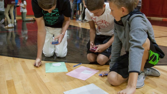 Students at Hurricane Middle School participate in Reality Store, an exercise designed to teach young kids the importance of money management and life choices Wednesday, Nov. 9, 2016.