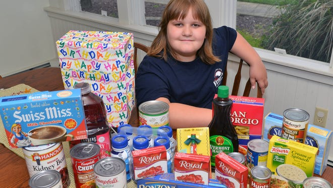 Instead of getting presents for her upcoming ninth birthday, Natalie Parkhill of Port Norris is collecting food to donate to veterans. <252><137>Natalie Parkhill, 8, of Port Norris is collecting food to donate to veterans instead of getting presents for her birthday to donate to the local veterans. <252><137>