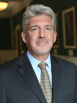 David Dunn, U of L's executive vice president for health affairs, is on leave pending an FBI investigation.