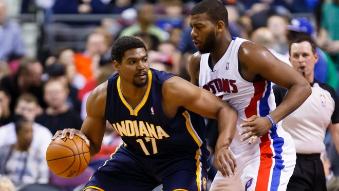 Mar 15, 2014; Auburn Hills, MI, USA; Indiana Pacers center Andrew Bynum (17) is defended by Detroit Pistons forward Greg Monroe (10) in the second quarter at The Palace of Auburn Hills. Mandatory Credit: Rick Osentoski-USA TODAY Sports