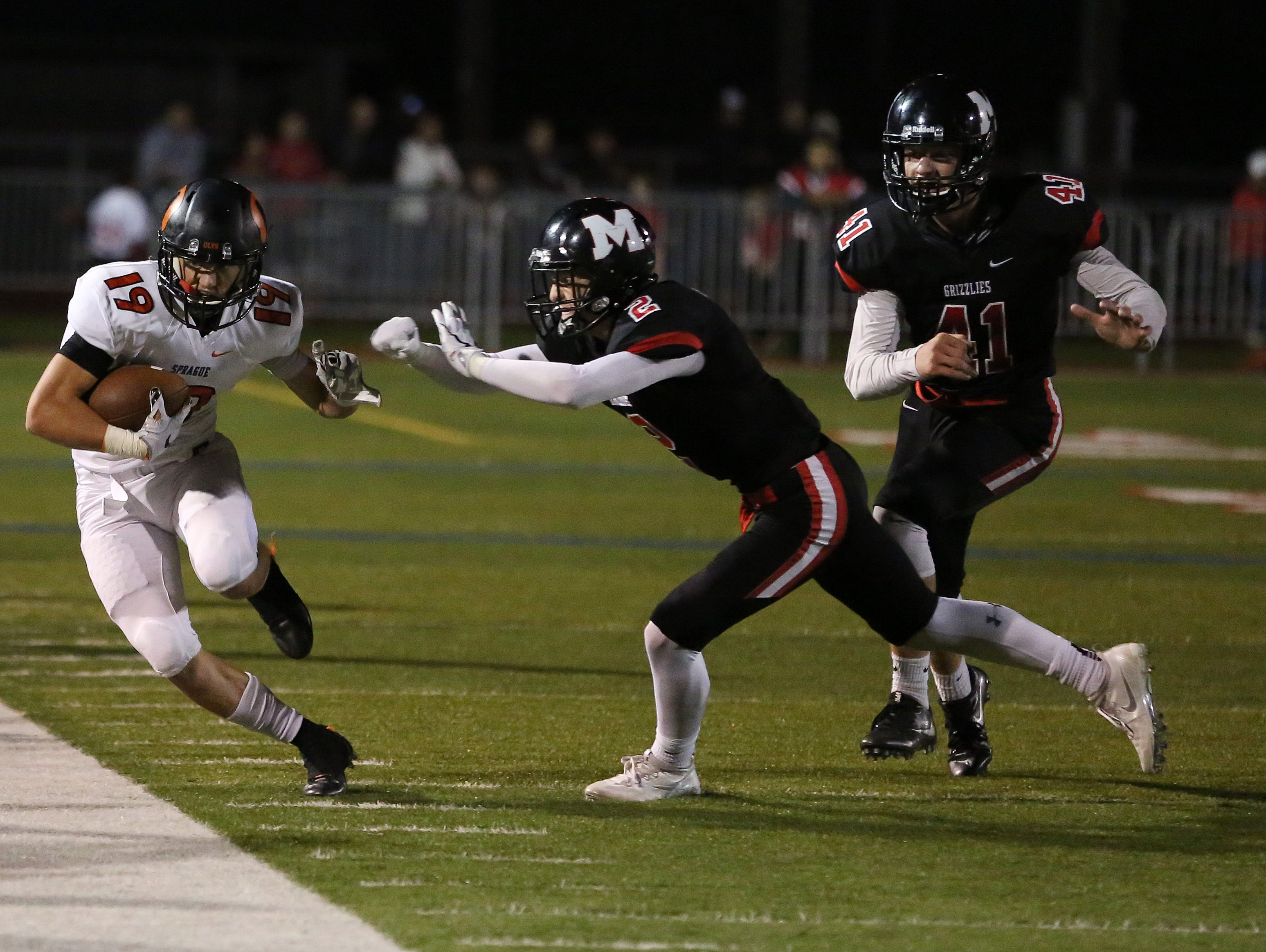 Sprague's Alek Altringer runs the ball as Olys defeat the McMinnville Grizzlies 49-27 in Greater Valley Conference game on Friday, Sept. 23, 2016, in McMinnville.