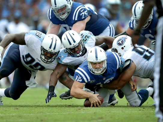 Indianapolis Colts quarterback Andrew Luck (12) falls