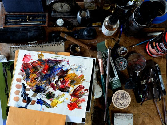 Portrait artist Michael Shane Neal's work table at