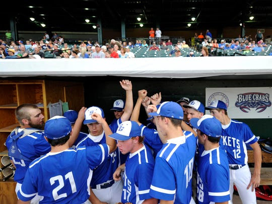 The Spring Grove baseball team, including first baseman and student section leader Austin Piety (17), huddles up before last season's District 3 Class AAA championship game at PeoplesBank Park in York. The Rockets fell to Donegal in extra innings. They return all but one player from that team, which qualified for the state tournament.