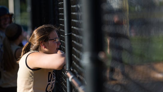 A Delone Catholic player cheers on her teammates  during