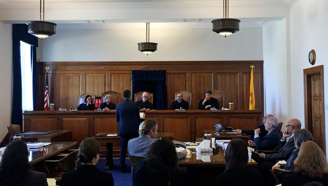 Bernalillo County District Attorney Raul Torrez fields questions from the New Mexico Supreme Court in Santa Fe,  on Wednesday, April 12, 2017. Prosecutors and public defenders are turning to the high court for guidance on how to apply new constitutional provisions that can keep suspects jailed without bond until trial. Justices heard arguments Wednesday aimed at clarifying what evidence must be presented at the suspects' detention hearings. Torrez says his requests for no-bond detentions are being unfairly dismissed.