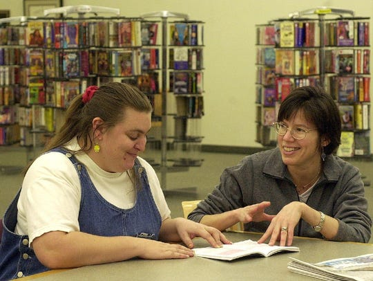 -  -Charlotte Welsch of Binghamton, left, laughs with