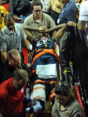 Aug 1, 2014; Las Vegas, NV, USA; USA Team Blue guard Paul George (29) is carted off on a gurney after injuring his leg during the USA Basketball Showcase at Thomas &Mack Center. Mandatory Credit: Stephen R. Sylvanie-USA TODAY Sports