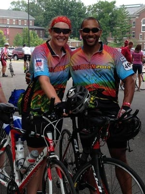 Sandy Taylor, left, and Craig Thompson, right, pose at a bike race event. On June 18, 2016, they'll begin a 3,000 bike race across America.