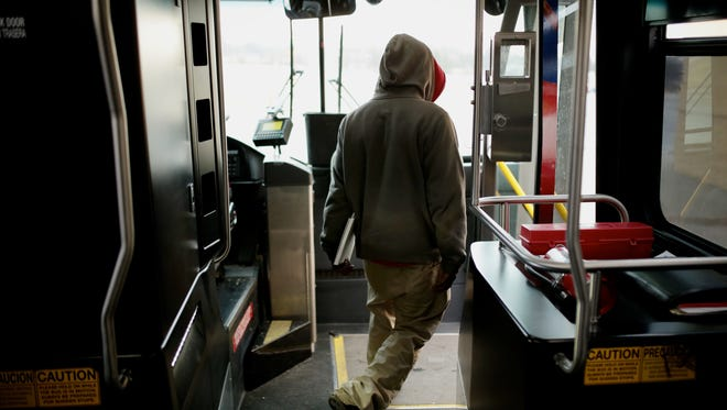 Bryant Pugh, 22, of Mt. Morris leaves the new Ride to Groceries bus to shop at Walmart on Tuesday, February 2, 2016, in Flint. Pugh is also an employee at Walmart. The bus service takes residents to three grocery stores on the outskirts of city of Flint.