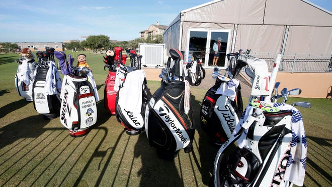 Golf bags are shown at a practice green as golfers prepare for the third round of the 2016 Valero Texas Open at TPC San Antonio - AT&T Oaks Course on April 23.