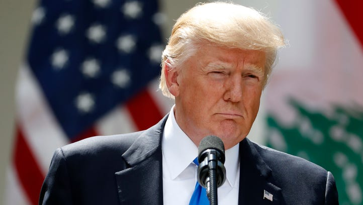 President Trump listens to a question during a news