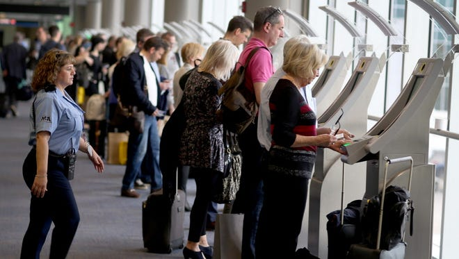 Passengers use the automated passport control kiosks set up for international travelers arriving at Miami International Airport on March 4, 2015 in Miami, Fla. The Department of Homeland Security unveiled a web page April 20, 2017, that allows travelers to compare expedited screening programs such as Global Entry and Precheck.