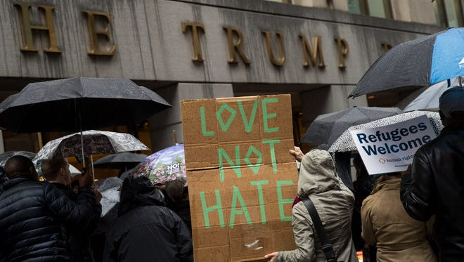 Protestors rally in front of the Trump Building on Wall Street in New York on March 28, 2017, against the Trump administration's proposed travel ban and refugee policies.