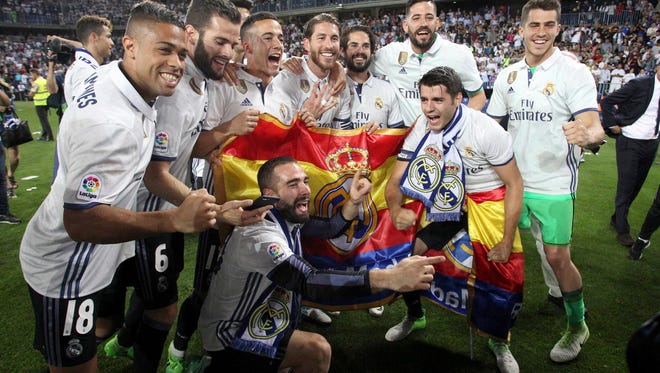 Real Madrid players celebrate winning the La Liga title for the first time in five years.