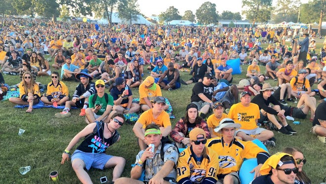 Hockey fans at Bonnaroo watch as Game 5 of Stanley Cup final between the Predators and the Penguins is shown on big screen at The Which Stage.