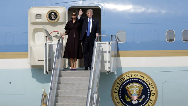President Trump and first lady Melania Trump disembark Air Force One.