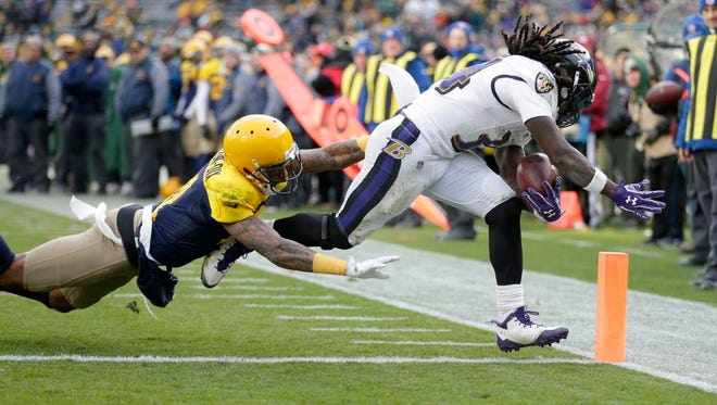 Baltimore Ravens defensive back Jaylen Hill (43) scores a touchdown asGreen Bay Packers free safety Ha Ha Clinton-Dix (21) tries to tackle during the 4th quarter of the Green Bay Packers 23-0 loss to the Baltimore Ravens at Lambeau Field in Green Bay, Wis. on Sunday, November 19, 2017.