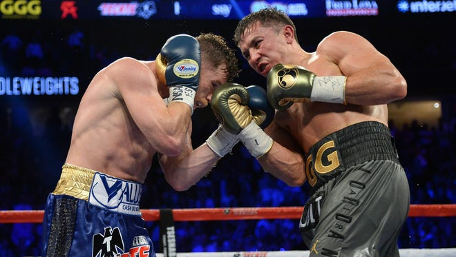Canelo Alvarez, left, and Gennady Golovkin exchange punches during their first encounter last September.