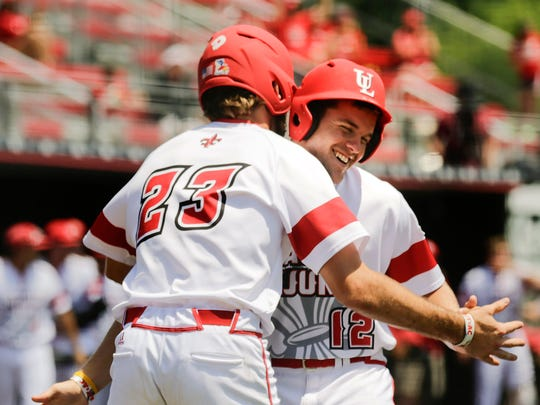 UL's Stefan Trosclair (23) and Joe Robbins (12) celebrate after both scored off Brad Antchack's eighth-inning single in Sunday's 4-1 win over Appalachian State.