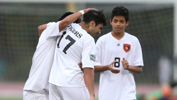 White Plains soccer players Chris Puelles (19) left,