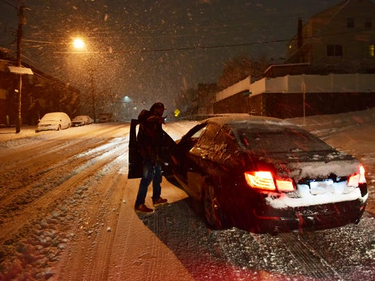 A stranded driver waits for help in Ridgefield, NJ
