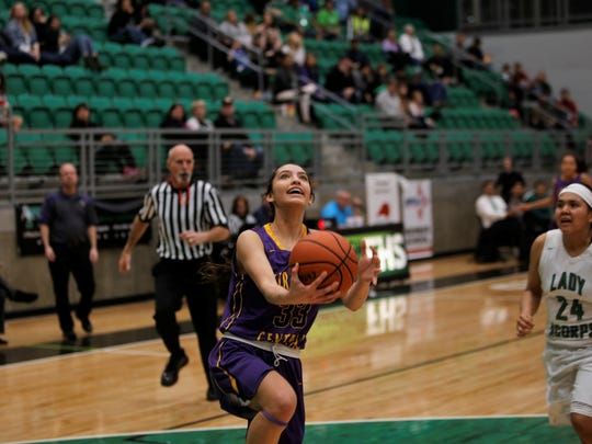 Kirtland Central's Talia Ockerman drives to the basket for a fast-break layup during a district game on Feb. 8 at Farmington. The Lady Broncos look to end to their current scoring slump, starting with Friday's 5A state playoff opener against the Scorpions.