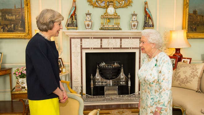 The new leader of the Conservative Party Theresa May is greeted by Britain's Queen Elizabeth II at the start of an audience in Buckingham Palace in central London on July 13, 2016.