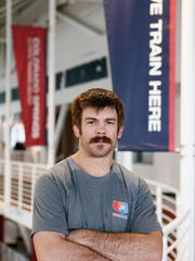 Andy Bisek navigated a challenging schedule of training and travel to graduate from Northern Michigan in 2010.