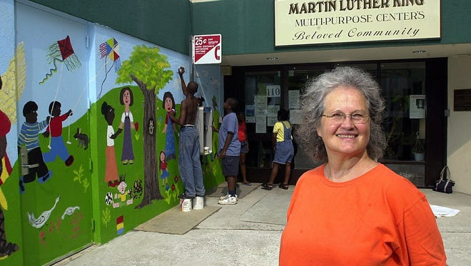 "Mariel Farlow of Spring Valley was helped by children ages 7 to 15, as well as some adults, in the design and painting of the ""Beloved Community"" mural at the Martin Luther King Multi-Purpose Center in Spring Valley in 2002."