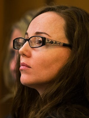 Marissa DeVault listens Feb. 20, 2014, to a former boyfriend testify in Maricopa County Superior Court.