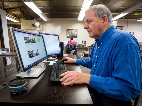 Passageway member Robert White, 62, works at one of the program's computers Thursday, Jan. 25, 2018, at their Des Moines offices. The program helps people with a variety of mental health challenges have a place to gather for fellowship, get volunteer and work experience and connect to social services for everything from food and housing assistance to setting up medical appointments.